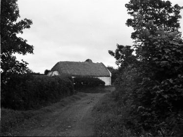 Farmhouse in the neighbouring parish of Inagh.  | The Photographic Collection, A015.19.00829 Image and data © National Folklore Collection, UCD.  CC-BY-NC 4.0  https://www.duchas.ie/en/cbeg/9305 accessed 8-1-20